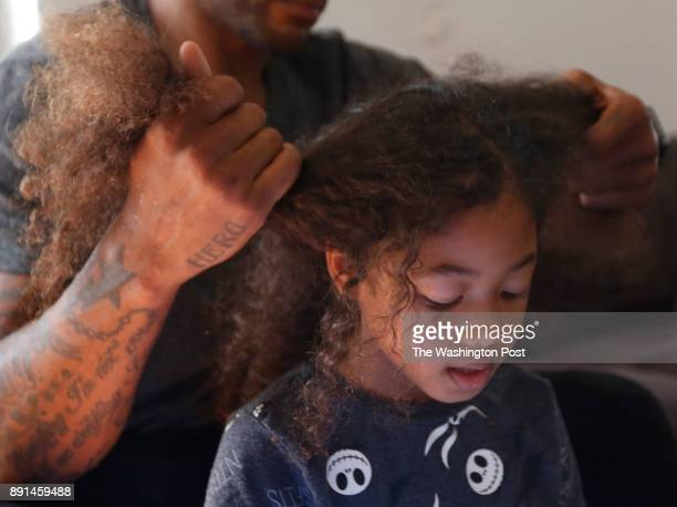 Larry Johnson braids his 7 yearold daughter Jaylen's hair as she reads her homework Johnson a former Pro Bowl running back believes he is living with...