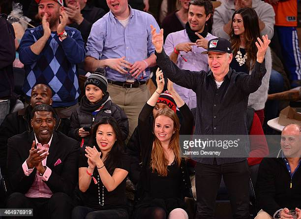 Larry Johnson guest Anna McEnroe and John McEnroe attend the Charlotte Bobcats vs New York Knicks game at Madison Square Garden on January 24 2014 in...
