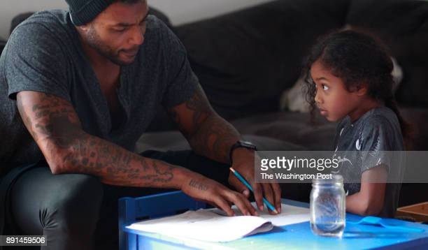 Larry Johnson helps his 7 yearold daughter Jaylen with her homework Johnson a former Pro Bowl running back believes he is living with CTE and says he...