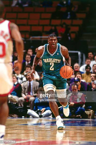 Larry Johnson of the Charlotte Hornets advances the ball against the New Jersey Nets during a game played circa 1991 at Brendan Byrne Arena in East...