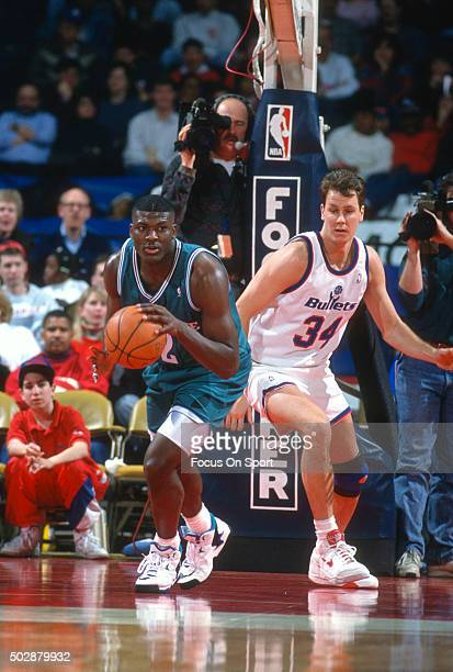 Larry Johnson of the Charlotte Hornets dribbles the ball against the Washington Bullets during an NBA basketball game circa 1993 at the US Airways...