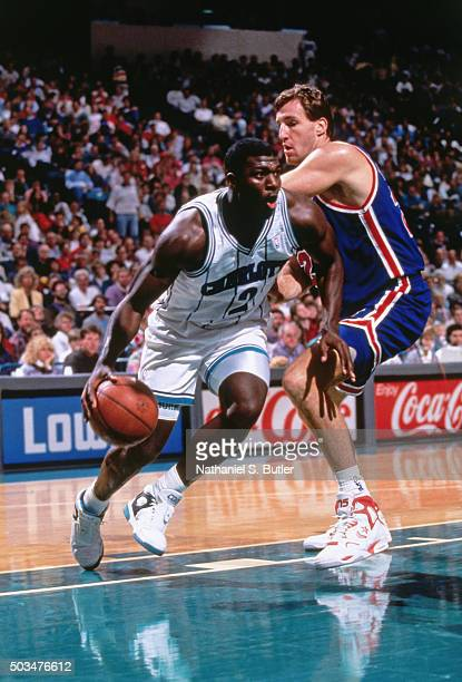 Larry Johnson of the Charlotte Hornets drives against Chris Dudley of the New Jersey Nets circa 1991 at the Charlotte Coliseum in Charlotte North...