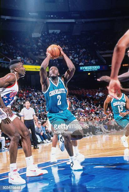 Larry Johnson of the Charlotte Hornets drives against the Philadelphia 76ers circa 1991 at the Spectrum in Philadelphia Pennsylvania NOTE TO USER...