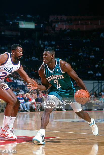 Larry Johnson of the Charlotte Hornets drives on Charles Jones of the Washington Bullets during an NBA basketball game circa 1991 at the Capital...