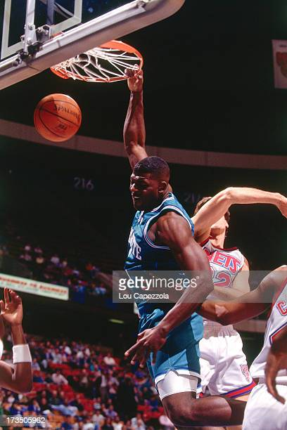 Larry Johnson of the Charlotte Hornets dunks against the New Jersey Nets during a game played circa 1991 at Brendan Byrne Arena in East Rutherford...
