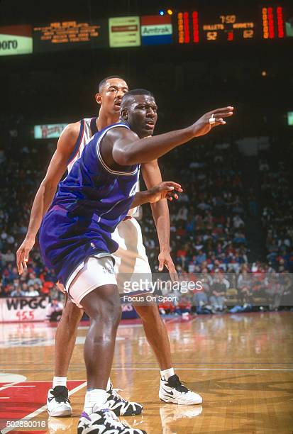 Larry Johnson of the Charlotte Hornets gets position on Juwan Howard of the Washington Bullets during an NBA basketball game circa 1995 at the US...