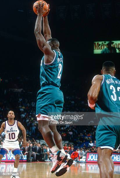 Larry Johnson of the Charlotte Hornets goes up to grab a rebound against the Washington Bullets during an NBA basketball game circa 1993 at the US...