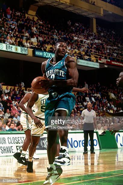 Larry Johnson of the Charlotte Hornets grabs a rebound against Acie Earl of the Boston Celtics during a game at the Boston Garden on November 12 1993...