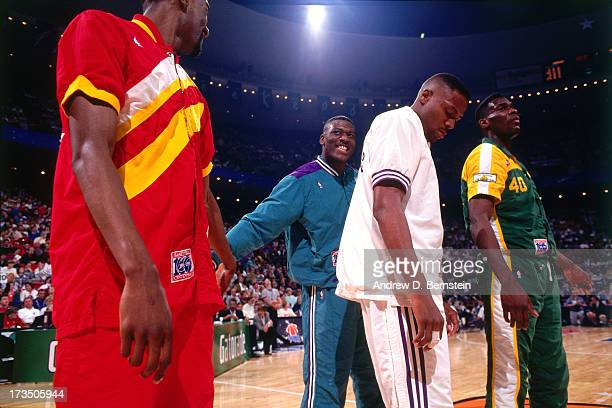 Larry Johnson of the Charlotte Hornets highfives former college teammate Stacey Augmon of the Atlanta Hawks before the 1992 Slam Dunk Contest at the...