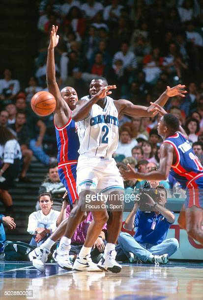 Larry Johnson of the Charlotte Hornets in action against the Detroit Pistons during an NBA basketball game circa 1993 at the Charlotte Coliseum in...