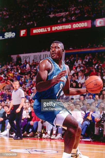 Larry Johnson of the Charlotte Hornets looks to pass the ball against the Philadelphia 76ers during a game played circa 1991 at The Spectrum in...