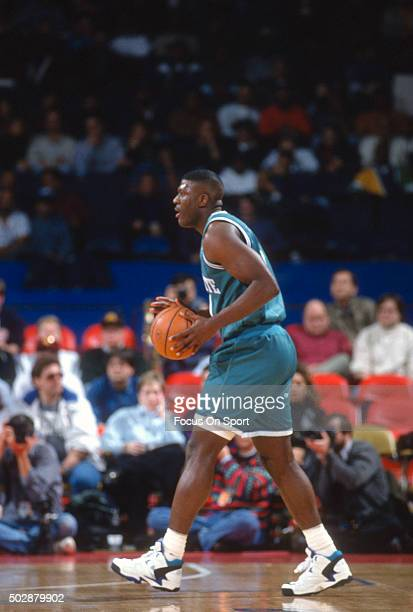 Larry Johnson of the Charlotte Hornets looks to pass the ball against the Washington Bullets during an NBA basketball game circa 1993 at the US...