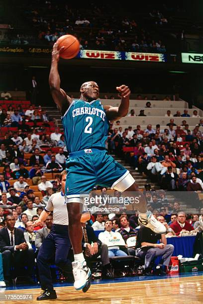 Larry Johnson of the Charlotte Hornets passes the ball against the New Jersey Nets during a game played circa 1991 at Brendan Byrne Arena in East...
