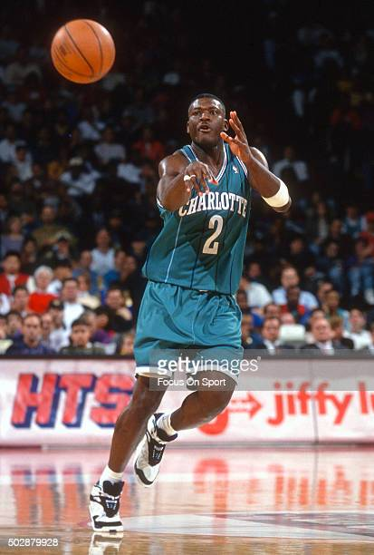 Larry Johnson of the Charlotte Hornets passes the ball against the Washington Bullets during an NBA basketball game circa 1993 at the US Airways...