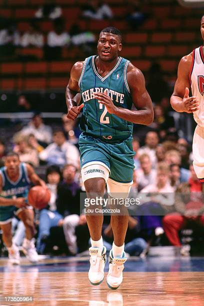Larry Johnson of the Charlotte Hornets runs up the court against the New Jersey Nets during a game played circa 1991 at Brendan Byrne Arena in East...