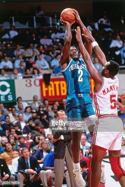 Larry Johnson of the Charlotte Hornets shoots against Danny Manning of the Los Angeles Clippers circa 1991 at the LA Sports Forum in Los Angeles...