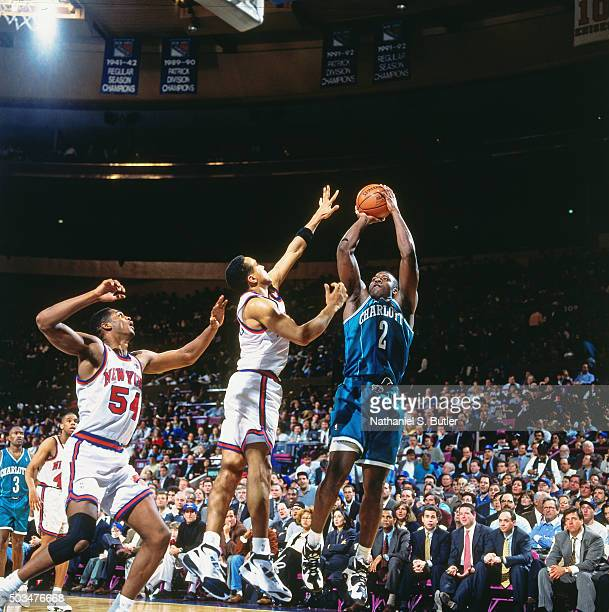 Larry Johnson of the Charlotte Hornets shoots against John Starks of the New York Knicks during a game played circa 1995 at Madison Square Garden in...