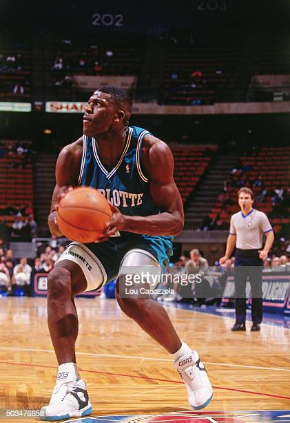 Larry Johnson of the Charlotte Hornets shoots against the New Jersey Nets circa 1991 at the Brendan Byrne Arena in East Rutherford New Jersey NOTE TO...