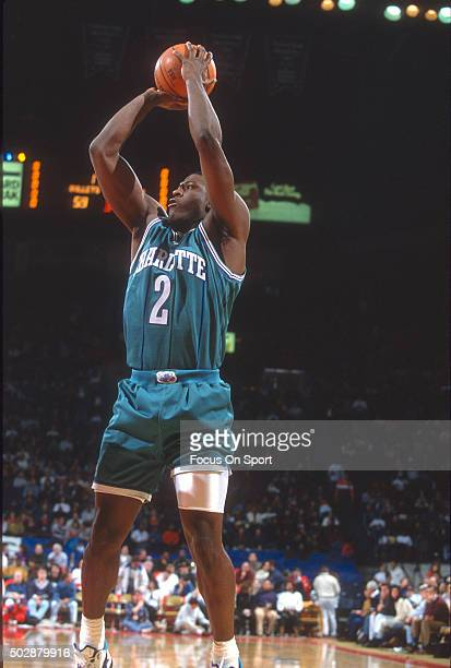 Larry Johnson of the Charlotte Hornets shoots against the Washington Bullets during an NBA basketball game circa 1993 at the US Airways Arena in...