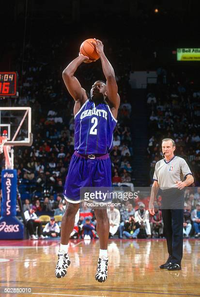 Larry Johnson of the Charlotte Hornets shoots against the Washington Bullets during an NBA basketball game circa 1995 at the US Airways Arena in...