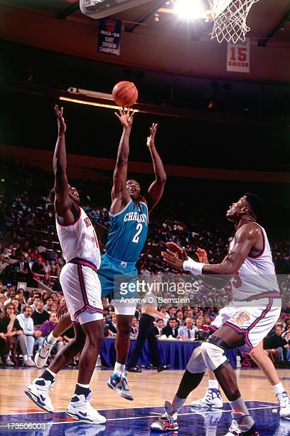 Larry Johnson of the Charlotte Hornets shoots over Patrick Ewing of the New York Knicks during a game played circa 1991 at Madison Square Garden in...