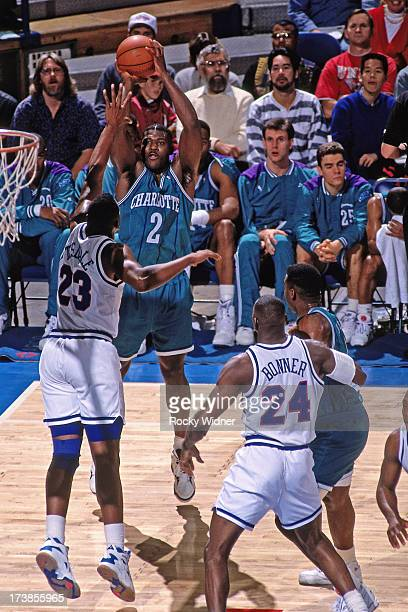Larry Johnson of the Charlotte Hornets shoots over Wayman Tisdale of the Sacramento Kings during a game played circa 1992 at Arco Arena in Sacramento...
