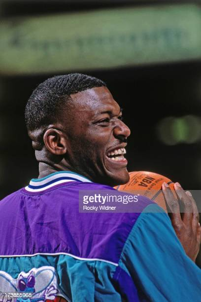 Larry Johnson of the Charlotte Hornets smiles before a game played against the Sacramento Kings circa 1992 at Arco Arena in Sacramento California...