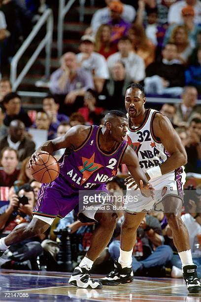 Larry Johnson of the Eastern Conference AllStars posts up against Karl Malone of the Western Conference AllStars during the 1995 NBA AllStar Game...
