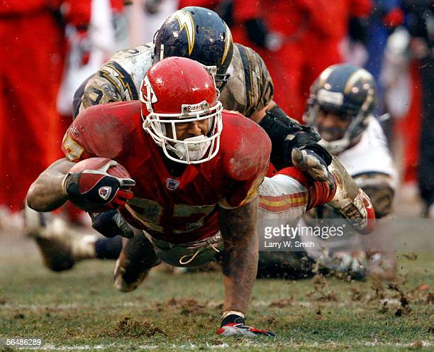 Larry Johnson of the Kansas City Chiefs is tackled by Luis Castillo of the San Diego Chargers in the fourth quarter on December 24 2005 at Arrowhead...