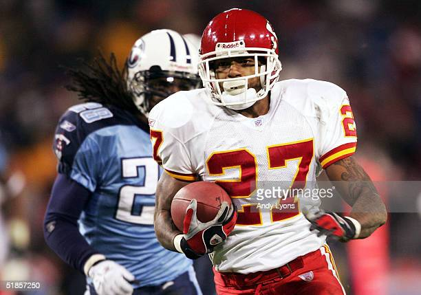 Larry Johnson of the Kansas City Chiefs runs for a touchdown during the game against the Tennessee Titans during Monday Night Football on December 13...