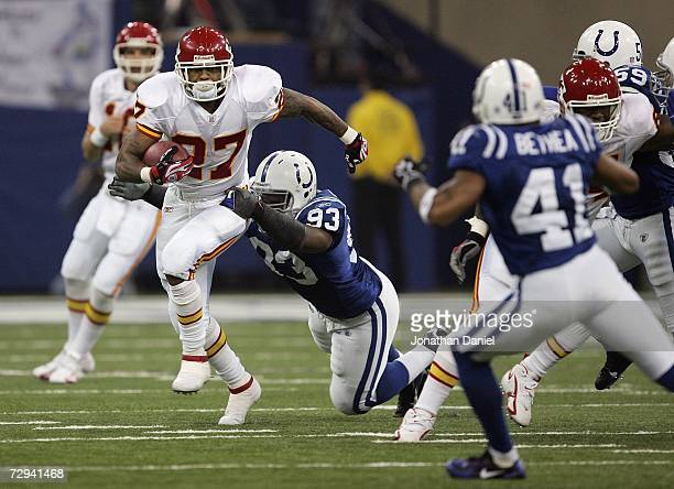 Larry Johnson of the Kansas City Chiefs runs the ball against Dwight Freeney of the Indianapolis Colts during their AFC Wild Card Playoff Game...