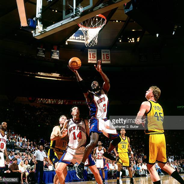 Larry Johnson of the New York Knicks drives to the basket for a layup against the Indiana Pacers during a 1999 NBA game at Madison Square Garden in...