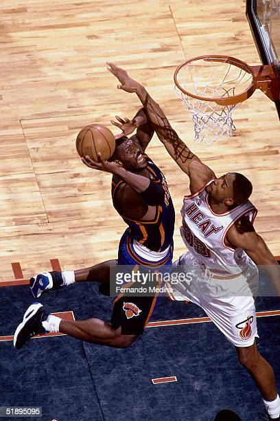 Larry Johnson of the New York Knicks goes for a dunk over Alonzo Mourning of the Miami Heat during the NBA game in Miami Florida NOTE TO USER User...