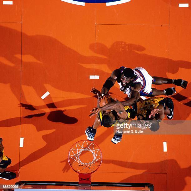 Larry Johnson of the New York Knicks is stopped by Indiana Pacer defenders in Game Three of the Eastern Conference Finals during the 1999 NBA...