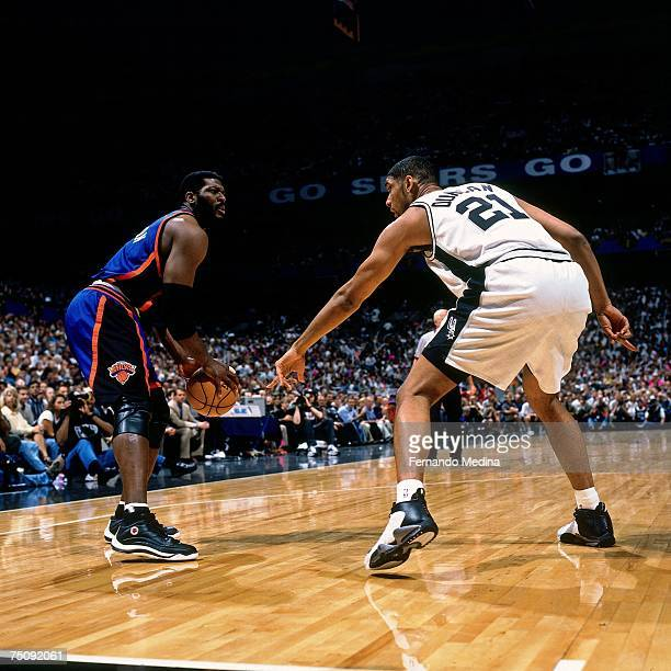 Larry Johnson of the New York Knicks looks to shoot over Tim Duncan of the San Antonio Spurs in Game Two of the 1999 NBA Finals played at the...