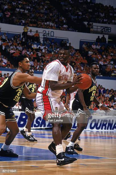 Larry Johnson of the University of Las Vegas Nevada Rebels looks to make a move during an NCAA game against Cal State Long Beach in March of 1991