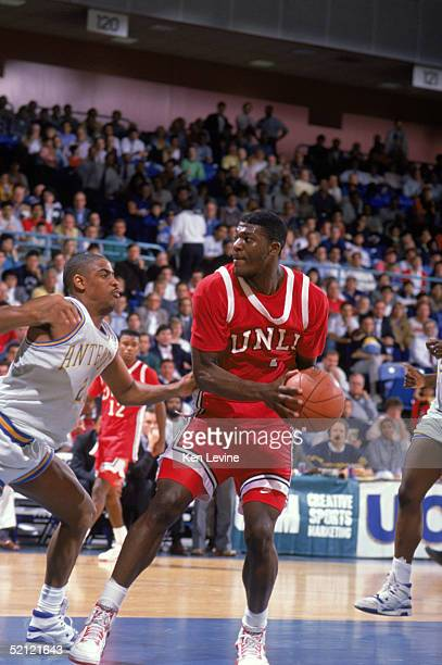 Larry Johnson of the University of Las Vegas Nevada Rebels looks to move the ball during an NCAA game against UC Irvine Anteaters in 1990