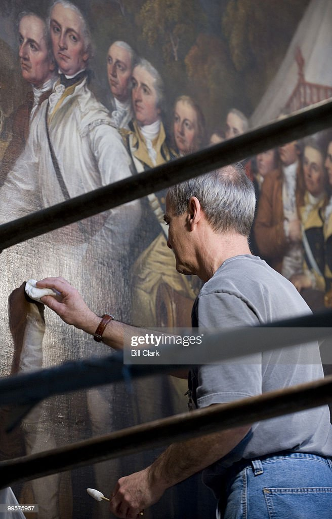 Larry Keck, a conservator with Olin Conservation, stands on scaffolding in the Capitol Rotunda to clean the 'Surrender of General Burgoyne' painting by John Trumbull on Wednesday, April 9, 2008.