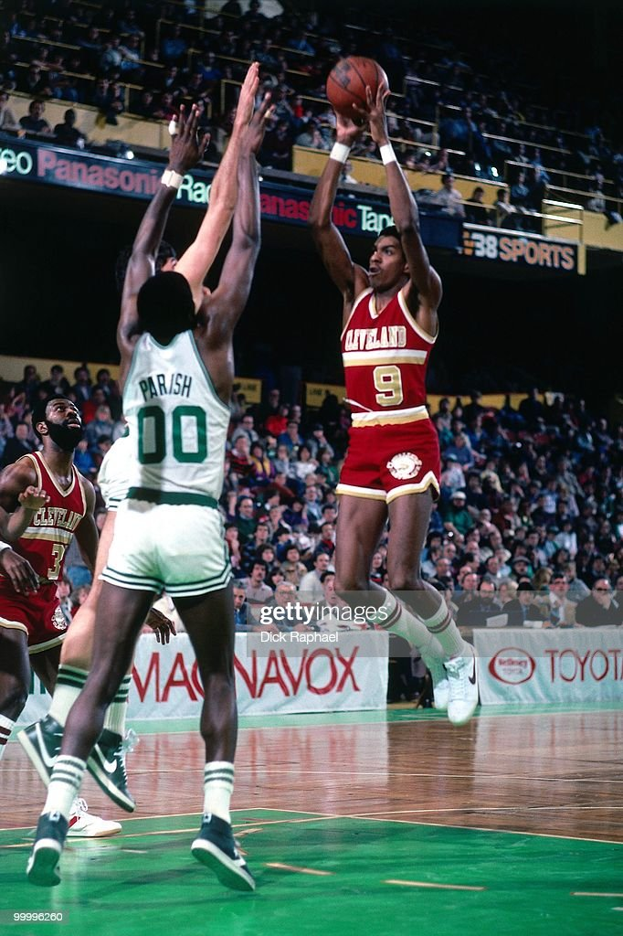 Larry Kenon #9 of the Cleveland Cavaliers goes up for a shot against Robert Parish #00 of the Boston Celtics during a game played in 1983 at the Boston Garden in Boston, Massachusetts.