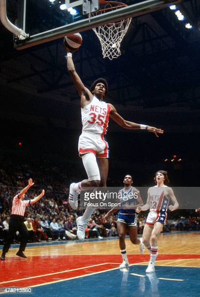 Larry Kenon of the New York Nets goes up for a slam dunk during an ABA basketball game circa 1973 at Nassau Veterans Memorial Coliseum in Long Island...