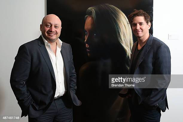 Larry Kestelman and Artist, Vincent Fantauzzo pose in front of his portrait unveiling of Charlize Theron on September 10, 2015 in Sydney, Australia.
