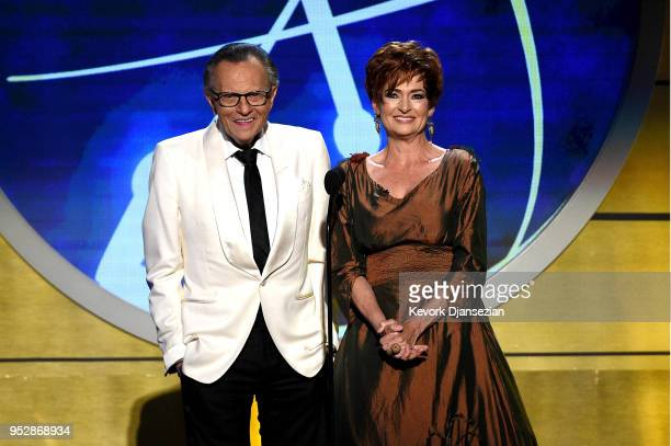 Larry King and Carolyn Hennesy speak onstage during the 45th annual Daytime Emmy Awards at Pasadena Civic Auditorium on April 29 2018 in Pasadena...