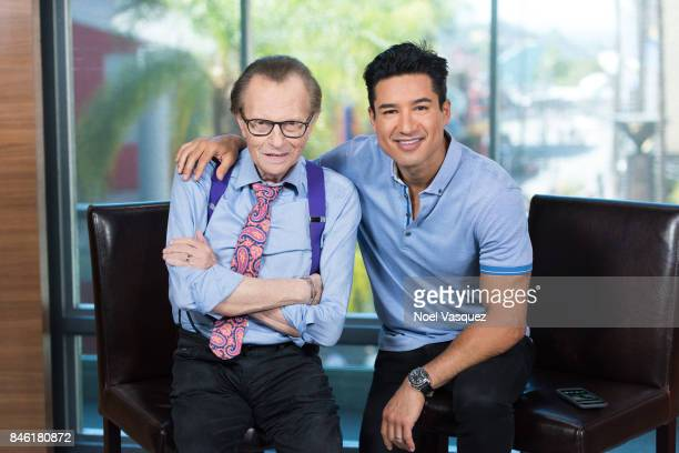 Larry King and Mario Lopez visit 'Extra' at Universal Studios Hollywood on September 12 2017 in Universal City California