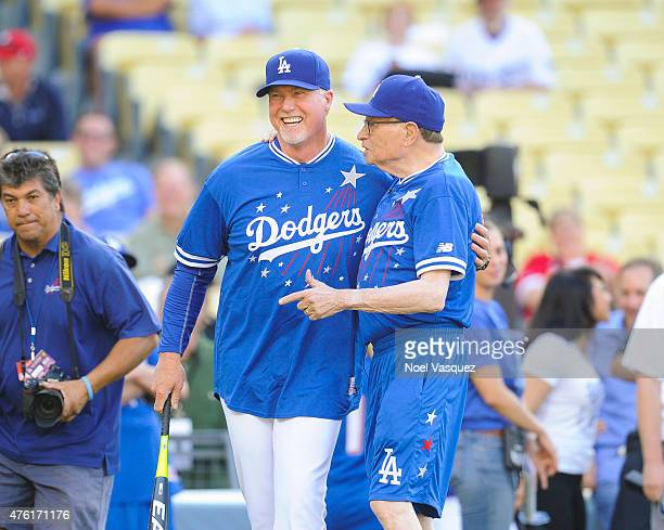 Larry King brings Mark McGwire pitch hitter at the Dodgers' Hollywood Stars Night Game at Dodger Stadium on June 6, 2015 in Los Angeles, California.