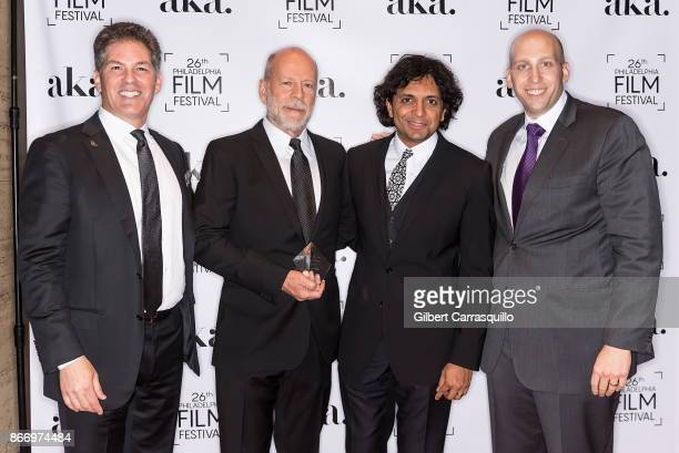 Larry Korman CoCEO of Korman Communities and President of AKA 2nd annual Lumiere award recipient actor Bruce Willis Film director M Night Shyamalan...