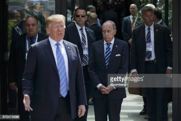 Larry Kudlow director of the US National Economic Council center listens as US President Donald Trump left speaks to members of the media following a...
