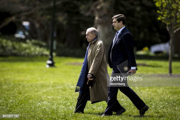 Larry Kudlow incoming director of the US National Economic Council left and John DeStefano assistant and counsellor to US President Donald Trump walk...
