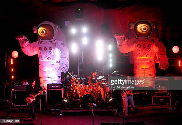 Larry LaLonde, Jay Lane, and Les Claypool of Primus perform in support of the bands 2010 Summer Tour at Red Rocks Amphitheatre on August 12, 2010 in...