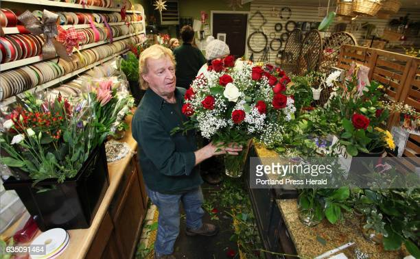Larry Leeman wraps up an arrangement of 26 roses in preparation for the Valentines Day holiday at Skillins Greenhouse Sunday Some orders ticketed for...