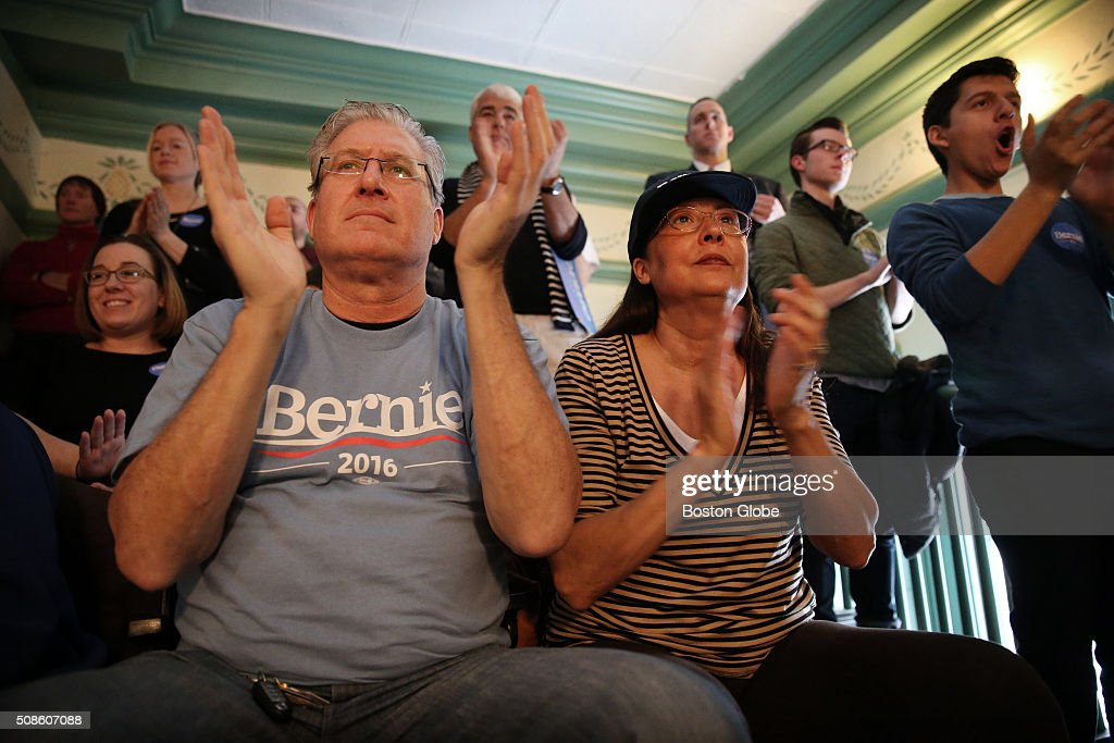 Larry Martin and Debbie Perou cheer as Bernie Sanders addresses the crowd during a 'Get Out the Vote' rally at Town Hall in Exeter, N.H. on Feb. 5, 2016.